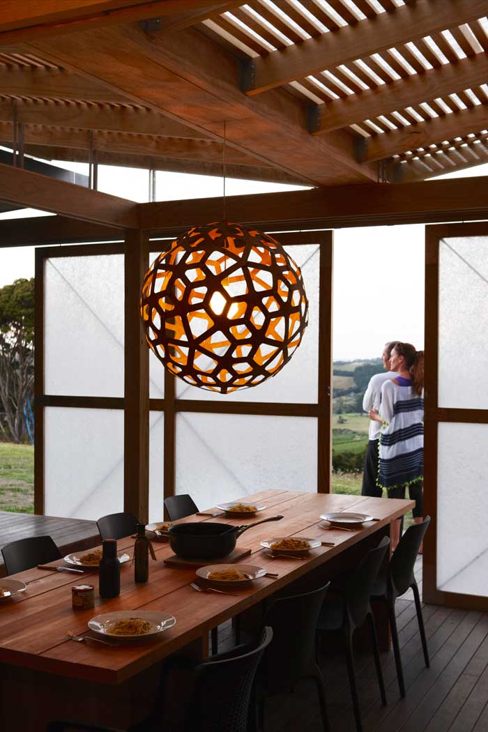 The dining space at dusk with backlit shoji screens.