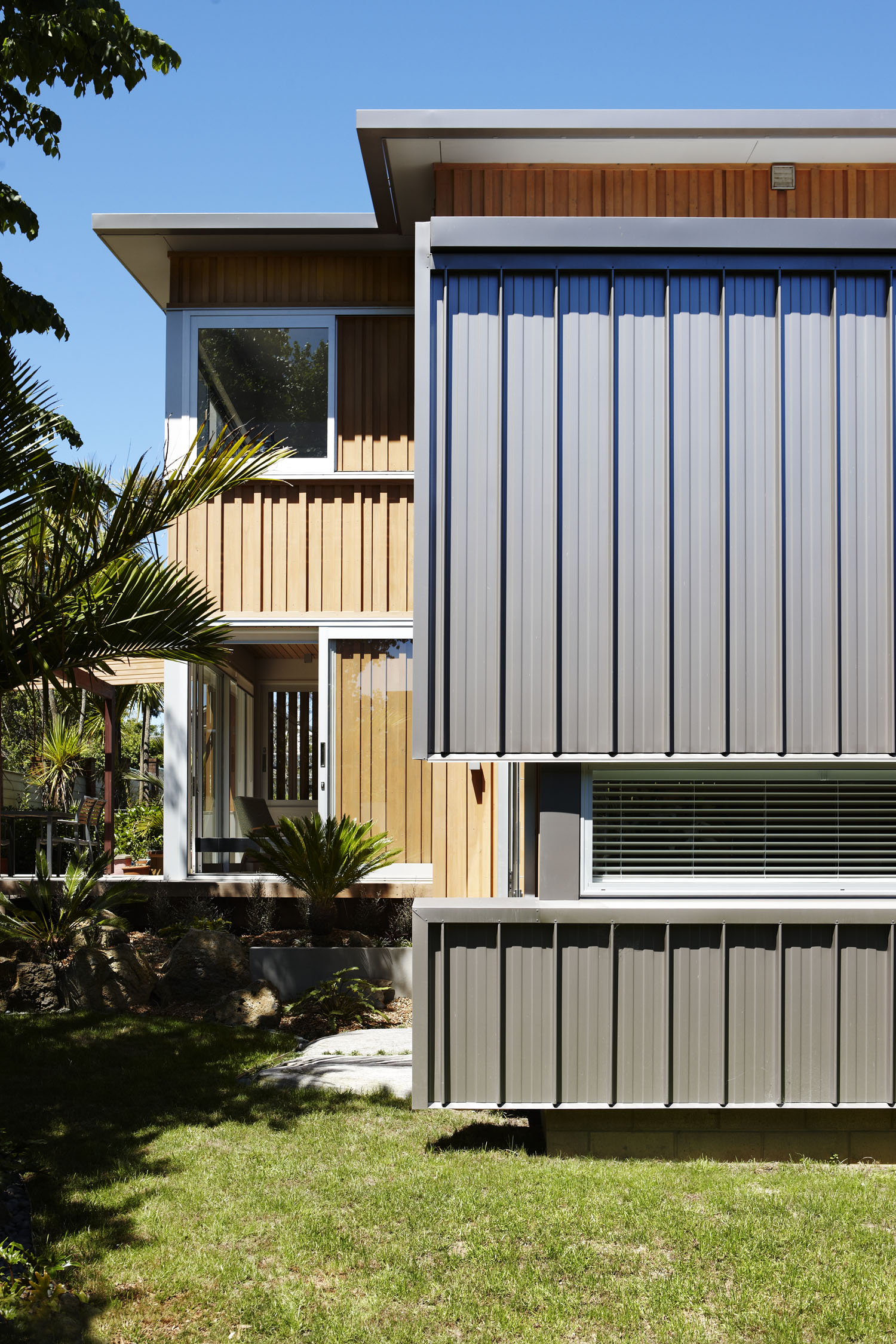 Dave Strachan townhouse roofing on library wall blends with timber cladding of main form