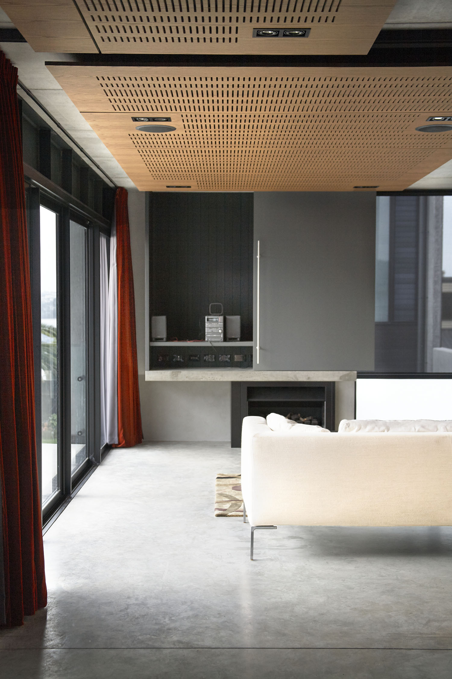 Gerrad Hall townhouse acoustic timber ceiling softens concrete reverberation